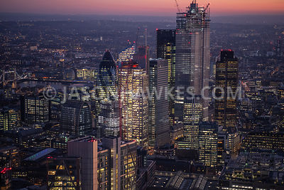 Dusk aerial view of the Heron Tower, 22 Bishopsgate, Tower 42 and Swiss Re Tower, City of London, London