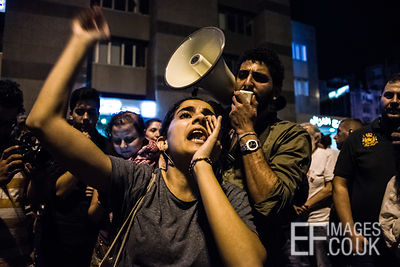 A passionate young women led anti-regime chants to crowds gathered at The Ring bridge near Downtown Beirut following a speach...