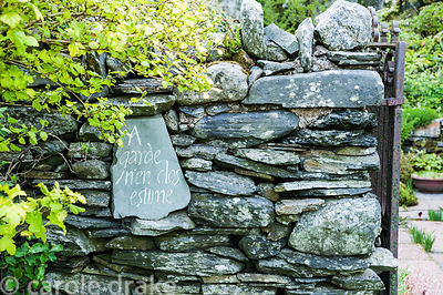 An inscribed slate inserted in a wall at the back of the former farmhouse reads 'A garde rien clos estime', 'A garden enclose...