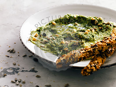 Hummus with spinach, dill and seeds.