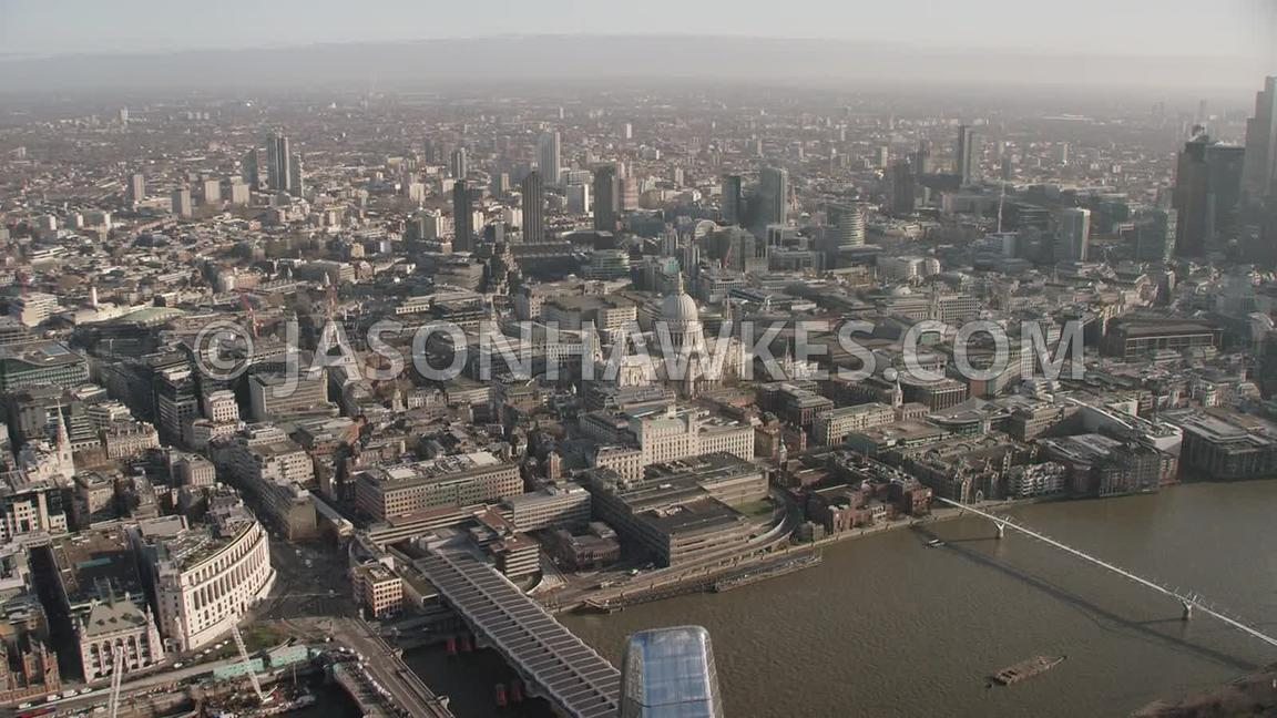 Aerial footage of the River Thames, St Paul's Cathedral and the Barbican, London.