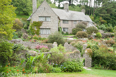House designed by Oswald Milne, built 1923-26, set within formal terracing planted with hot coloured flowering perennials and...