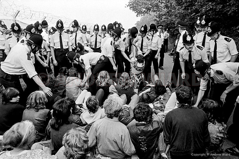 England,UK. 8.7.1983 Greenham Common. Peace Camp women protest against cruise missiles along the torn down perimeter fence of...