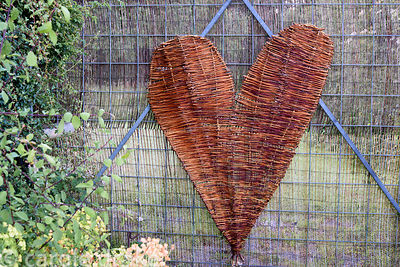 A woven willow heart on a gate at Malthouse Farm, Hassocks, Sussex