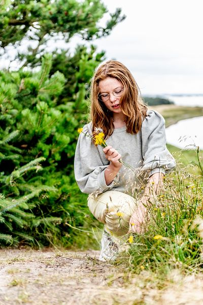 Girl picking flowers on Venø, Denmark 2