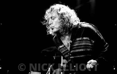 Robert Plant performing lvie with the Priory of Bryon at Cambridge Folk Festival 2000