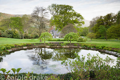 Upper pond with views down the garden, across the house and to the surrounding Conwy countryside.