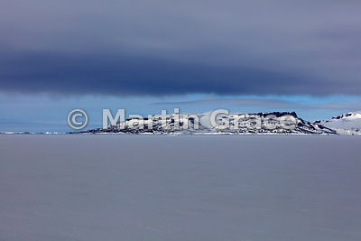 Dark sky over land, Weddell Sea, Antarctica