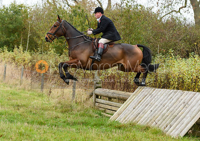Ian Arthur jumping a hunt jump near Peake's. The Cottesmore Hunt at Somerby