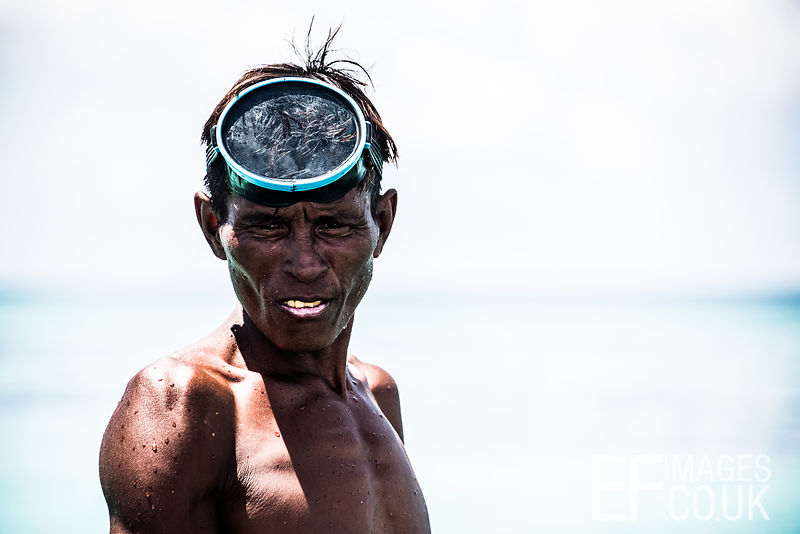 1._A_fisherman_between_dives_for_octopus_in_a_more_typical_protrayal_of_the_stateless_Bajau_Laut_people_of_the_Celebes_Sea_cl...