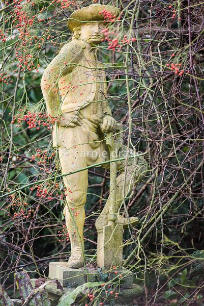 Statue of a gardener resting on his spade at the Old Rectory, Netherbury in January