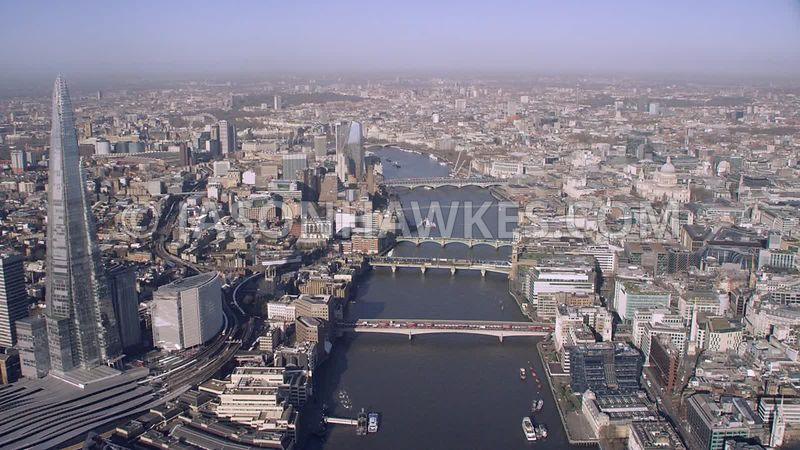 Aerial footage of the Shard, River Thames, Tate Modern, Borough, More London,  Southwark, London.