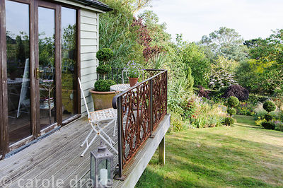 Debbie's garden studio with balcony looking out across the sloping garden.