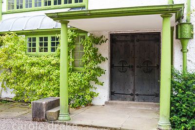 Porch over the north facing front door, with all exterior wood and metalwork pained in Voysey green. House dated 1895. Perryc...