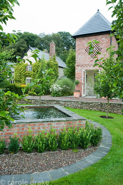 Square pool with dovecote behind, built in 2007 to echo the barn. Rhodds Farm, Kington, Herefordshire, UK
