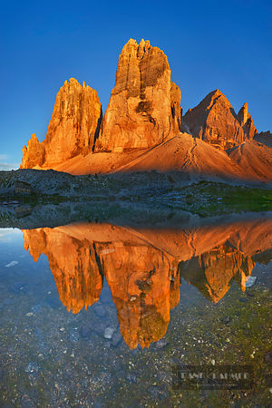 Mountain impression Tre Cime reflected in source of Rienza - Europe, Italy, Veneto, Belluno, Sexten Dolomites, Tre Cime, Rien...