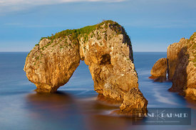 Cliff landscape with rock arch - Europe, Spain, Asturias, Oriente, Ribadesella, Playa de Huelga (Bay of Biscay, Costa Verde) ...