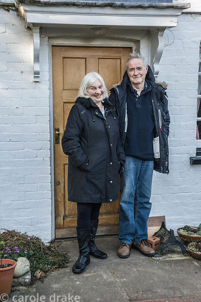 Dr John and Margaret Noakes outside their home, Old Church Cottage.