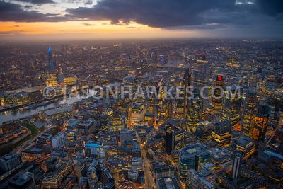 Dusk aerial view of Aldgate and the City of London, London.