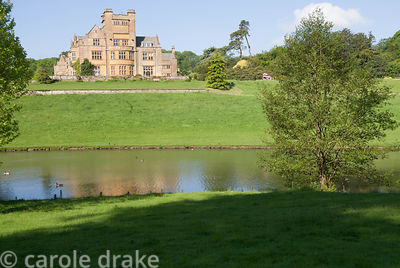 East face of Minterne House, built 1905, designed by Leonard Stokes, seen from parkland across the lake. Minterne, Minterne M...
