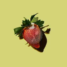 Ripe Strawberry on green background