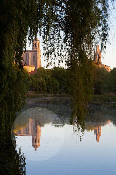 Girona Cathedral (Catedral de Girona) reflected on Ter river (riu Ter) at Sunset