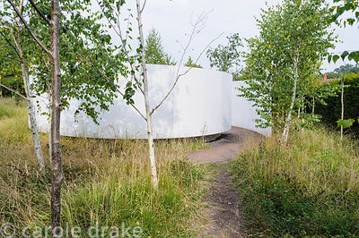 Glade of 85 silver birch trees with a simple circular poustinia at its centre, a place to pray.
