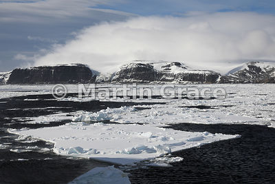 Weddell Sea landscape of ice, land, sea and cloudy sky, from Latitude: S63°46.538', Longitude: W57°10.665'; Antarctic Peninsu...