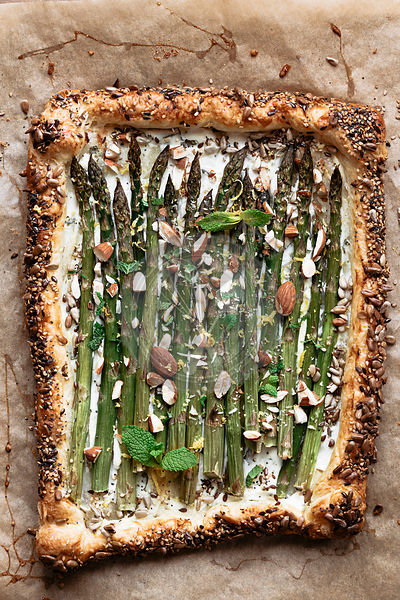 Asparagus tart with ricotta, almonds, mint