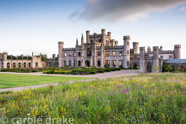 The shell of Lowther Castle, Penrith, Cumbria in July framed by wildflower meadows and a parterre designed by Dan Pearson