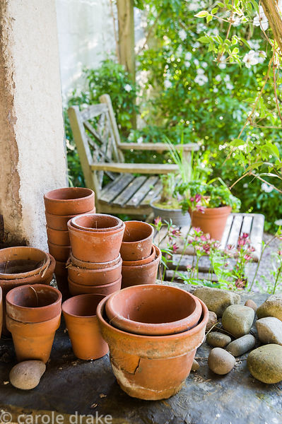 Collection of old terracotta pots and pebbles.