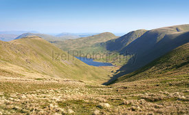 Views of Hayeswater reservoir below the summits of High Stret, Gray Crag and Rest Dodd on a sunny morning in the Lake Distric...