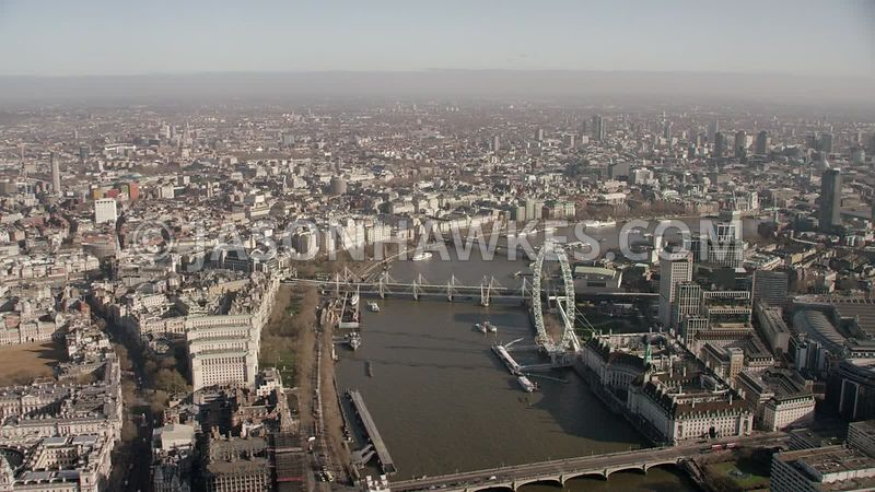 Aerial footage of the River Thames, Westminster, Southbank, The Strand, London Eye, Westminster Bridge, London.