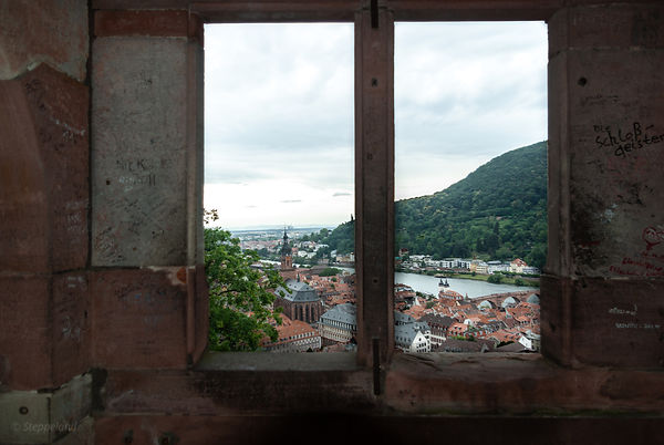 View on the old city through Castle window, Heidelberg