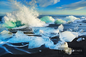 Wave breaking at iceblocks washed ashore - Europe, Iceland, Eastern Region, Jökulsarlon (Vatnajökull National Park) - digital