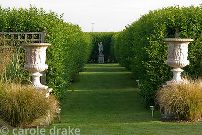 Classical statues lurk within a maze of privet hedges that create areas of calm from the prevailing winds. Ednovean Farm, Mar...