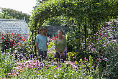 Steve and Phillippa Lambert in their walled garden. Haddon Lake House, St Lawrence, Isle of Wight, UK