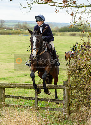 Isobel McEuen jumping onto Bruce's Lane. The Cottesmore Hunt at Somerby