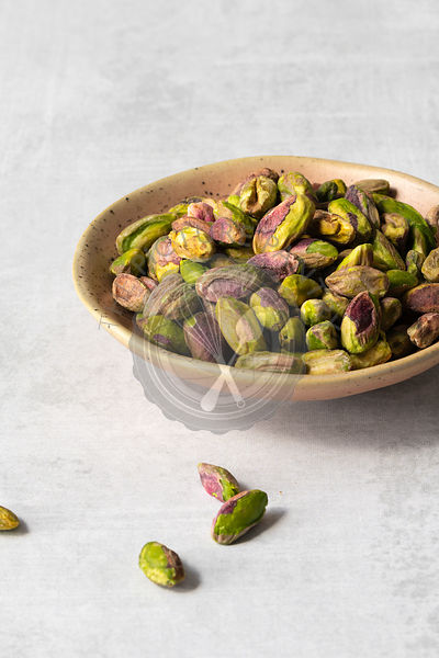 Pistachio nut kernals in a small bowl.