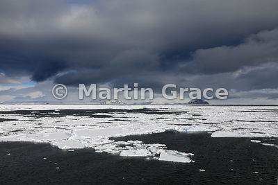 Weddell Sea landscape of ice, land, sea and cloudy sky, from Latitude: S63°46.470', Longitude: W57°10.676'; Antarctic Peninsu...