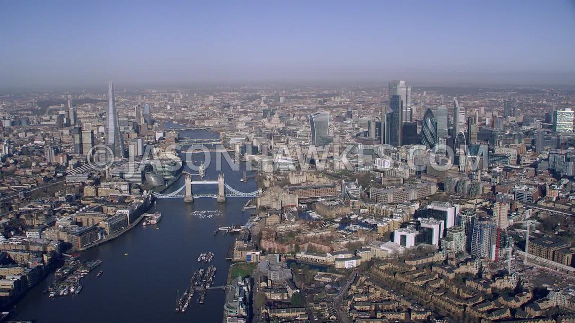 Aerial footage of the River Thames, The Shard, Tower Bridge, City of London, St. Katharine Docks,  The Tower of London, London.
