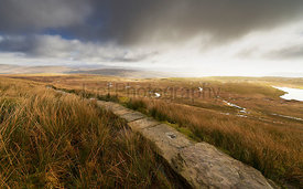 The stone path winding it's way through Blea Moor to the summit