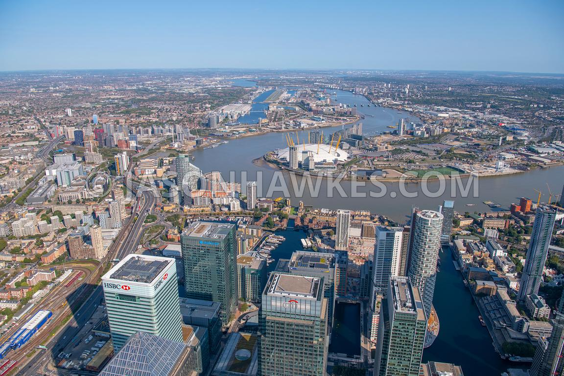 Canary Wharf and Greenwhich Peninsula, River Thames, aerial view, London.