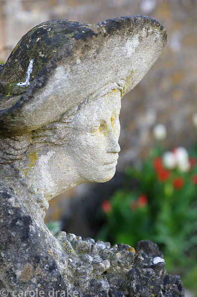 Stone carving of a woman by Simon Verity at Barnsley House, Cirencester, Glos, UK