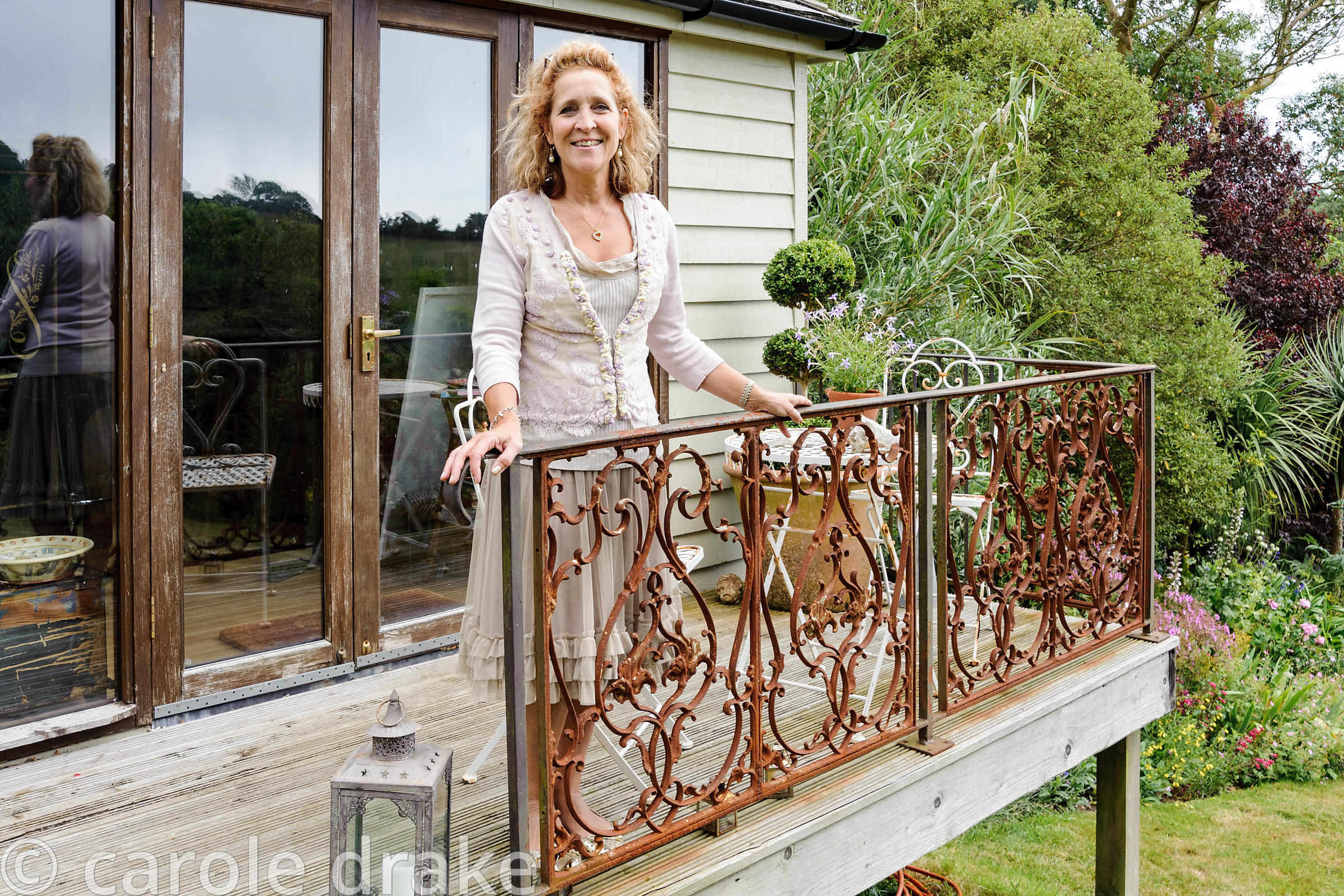 Debbie Bell on the balcony of her garden studio.