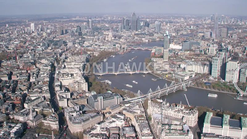 Aerial footage of Charring Cross, Embankment, River Thames and SouthBank, London.