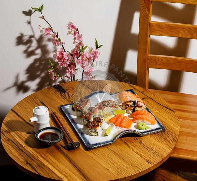 Sashimi and Nigiri sushi set on wooden table