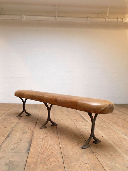 Cast iron legs leather bench