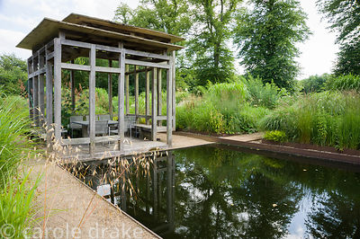 At the centre of the minimalist front garden, designed by Christopher Bradley-Hole, is a contemporary green oak summerhouse b...