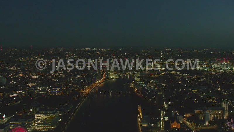 Night aerial helicopter footage from Westminster, Houses of Parliament , London Eye and Lambeth down River Thames to  Nine El...